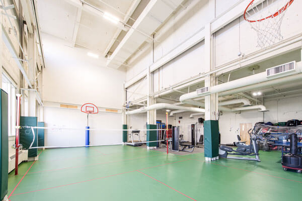 BSEC Gymnasium With Green Floors And Basketball Nets small